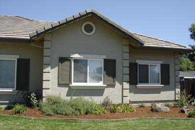 Stucco Quoins, window sill, flat trim on top of window, circle